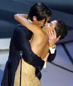 Adrien Brody Plants A Kiss On Halle Berry